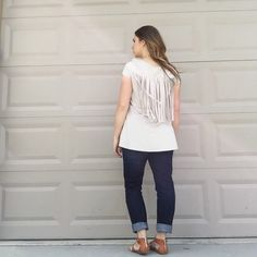 "Oatmeal Suede Fringe Tunic This faux suede short sleeve tunic shirt is not only cute, it is super comfortable. Darling fringe accent. Roughly 29.5"" from shoulder to hem. Also available in an blush. Limited availability. These will go fast so snag yours quick! Entro Tops Tunics"