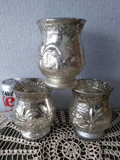Silver mercury glass candle holders.   Only led candles allowed,  wax or water ruin mercury glass.   If using for a flower vase,  I have inserts to hold flowers/water.  10 of these available.     To rent this or any other items on this board, please call me at 801.427.2276