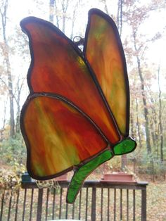 Red and green butterfly stained glass sun catcher