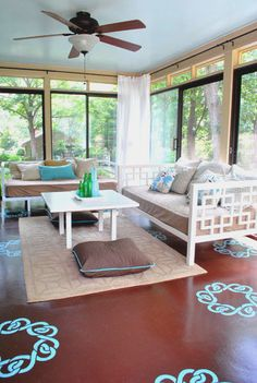 Sunroom - love those super-high privacy curtains and the floor pillows