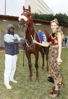 Fashion and racing, a match made in heaven. Groom Zwelisha (left) shows KwaZulu-Natal hope Gothic to model Phillipa Godson (ICE Models), wearing a design by Minette de Swart from the Vodacom Durban July fashion Challenge. Fashion Challenge, Style Challenge, Kwazulu Natal, Races Fashion, Made In Heaven, Match Making, Trendy Fashion, Gothic, Groom