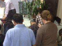 Sis. Beth praying with the people in El Salvador.