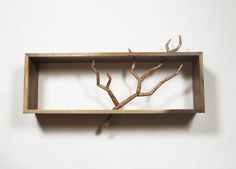 """This cabinet features a hand-carved birch """"branch"""". Each segment of the branch is doweled together for durability, and hand-carved to represent a live branch."""