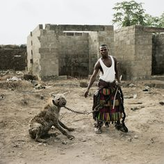 "Jatto with Mainasara, Ogere-Remo, NIgeria, aus 'Gadawan Kura' - ""The Hyena Men Series II, By Pieter Hugo. C-print. Hyena Man, Transformers, Baboon, Foto Art, Beauty And The Beast, Beauty Beast, Animal Photography, Portrait Photography, Pop Culture"