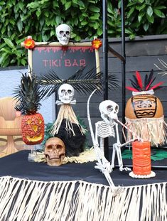 Guests will love being served by a spooky skeleton bartender at this DIY Backyard Halloween Luau Tiki Bar! Learn how to set it all up, including how to create DIY pineapple jack-o-lanterns, painted pumpkins, and more at fernandmaple.com!