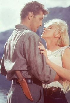 """Robert Mitchum and Marilyn Monroe in """"River of No Return"""""""