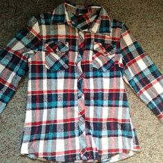 Red White and Blue Women's Flannel Red white and blue plaid flannel. Pretty thick material, classic flannel with two breast pockets, button adjustable sleeves, and buttons down the front. All buttons are in tact and the waist add a feminine look. Only worn once (too big in the shoulders and waist) Labelled as a 2x buy fits more like a medium Tops Button Down Shirts