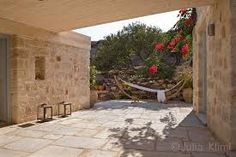 Stone house in Patmos Modern Patio, Stone Houses, Common Area, Architect Design, Atrium, White Marble, Natural Materials, Cottage, Exterior
