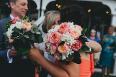 A Coral, Colourful Village Fete Inspired Wedding  Coral and white flowers