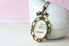 """heart"" necklace made from 1915 sheet music"
