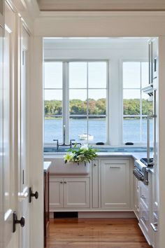 A lake front home with amazingly large windows in the kitchen. Yes please!!!