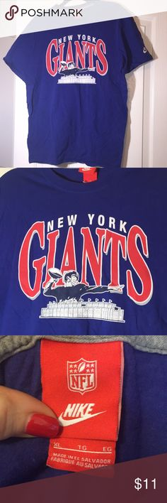 "Nike NFL Giants tee shirt. Size XL. Nike NFL Giants football short sleeves tee shirt. Size XL but is smaller, more like a medium. Has pix of stadium. 21"" between armpits. Length 28"". nike nfl Shirts Tees - Short Sleeve"