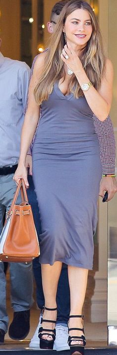 Sofía Vergara: Sunglasses = Tom Ford  Dress = James Perse  Purse = Hermes  Shoes – Charlotte Olympia