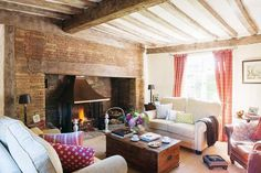 A classic thatched cottage from the outside, the interior of Lesley and Kevin White's Suffolk home is an eclectic mix of English country and Balearic influences