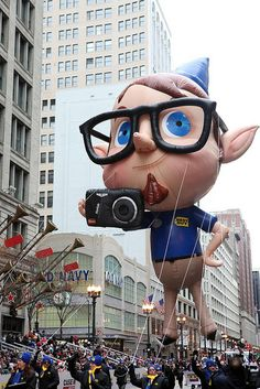 Directly from the North Pole, Kenneth the Blue Elf makes his way up the McDonald's Thanksgiving Parade route in 2010.  During his trip, the Kodak camera in his hand took pictures that were posted live on Facebook.  In 2009, Kenneth was presented by Best Buy.