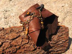 Leather Cuff Bracelet, Beaded Wrist Wrap, Wristband  Urban Warrior OOAK. $34.00, via Etsy.