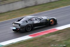 Ferrari 599XX spitting flames and glowing brakes
