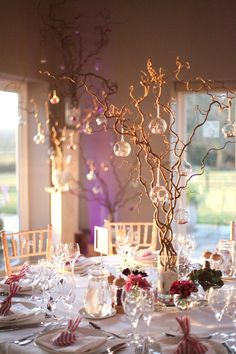 Enchanted forest or midsummer nights dream wedding inspiration. Twisted willow and hanging glass vases decorations