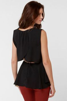 love the back of this basic black blouse.. paired with some awesome jewelry, perfect.