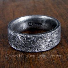 """""""Rustic Ring""""palladium men's wedding band Inspired by a lifestyle, a new scuff or scratch will only add to the beauty of this ring. It's rough, rustic, and distressed. This men's wedding band is 7mm wide, and is hand fabricated from palladium with a comfort fit interior."""