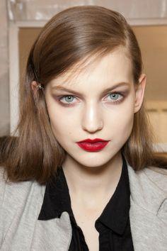 NIna Ricci, pale skin, retro red lips.