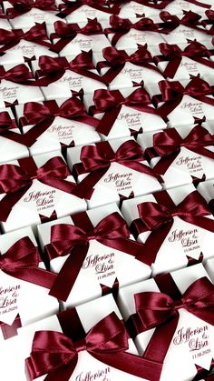 Elegant wedding favor box with wine burgundy satin ribbon bow and custom tag. Personalized gift boxes make a unique way to thank guests for attending your special day. #welcomebox #giftbox #personalizedgifts #weddingfavor #weddingbox #weddingfavorideas #bonbonniere #weddingparty #sweetlove #favorboxes #candybox #elegantwedding #partyfavor #giftboxes #uniqueweddingfavors #burgundywedding