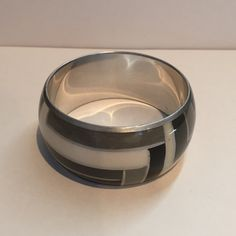 NWOT Black geometric bracelet New black, white, and grey geometric bracelet. No trades. Reasonable offers accepted. Thank you for looking at my closet! Jewelry Bracelets