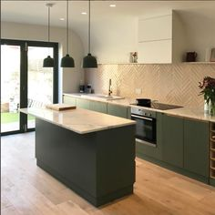 Plywood and granite kitchen by Lozi. Lozi offers a wide range of bespoke kitchens.  Designed to maximise your own individual space, each kitchen is beautifully designed and made to measure.