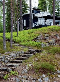 hand-hewn stone steps lead to a cottage painted black with white trim Cozy Cottage, Garden Cottage, Cottage Homes, Lake Cabins, Cabins And Cottages, Dark House, Garden Steps, Cottage Design, Green Life