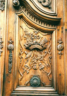 This door is amazing.  I'd hang it over a massive limestone fireplace with an iron balcony
