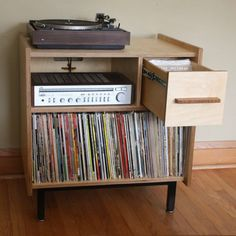 The Princeton - Small Audio Credenza that holds 150 LPs and features cord management and drawer with partitions. Offered by Brokenpress Design+Fabrication