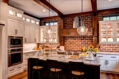 Brick wall in kitchen with white cabinets, glass cabinet doors to exposed brick - Gray accent in kitchen - rustic craftsman kitchen with industrial accents - Farinelli Construction - Featured from Street of Dreams, FOR SALE! Exposed Brick Kitchen, Brick Wall Kitchen, Exposed Brick Walls, Kitchen Backsplash, Backsplash Ideas, Kitchen Cabinets, Kitchens With Brick Walls, Brick In The Kitchen, Brick Wall Decor