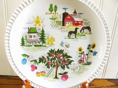 Ill be happy to give you a quote for your zip code! Pass the biscuits please...on this adorable country plate! It has farm scenes of an apple tree, farm house, barn, horses, chickens and sunflowers. Would be perfect for serving bread or to hang on your wall in your kitchen or dining area. In very good condition with some typical vintage wear, a few light scratches etc but otherwise, very nice! It has V-3249-A on the back. Measures 10  The listed shipping cost is an ESTIMATE for continental…