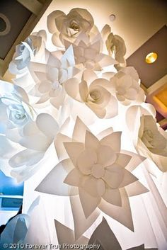 make giant paper flowers with eyes and mouths