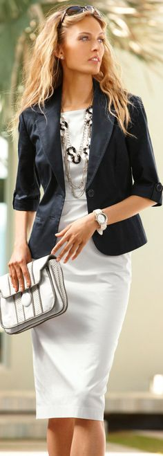 Neutral Dress and Blazer + Statement Necklace. Pair a light grey, beige or white dress with a black blazer for a look that is sophisticated and authoritative. Pair with a statement necklace or shoes for a professional pop.