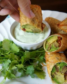 Avocado egg rolls with cilantro ranch dressing.