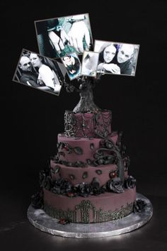 This cake is all sorts of awesome. I especially like the photo's instead of cake toppers that only vaguely look like the couple.