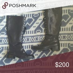 Black lace up via spiga boots Black lace up moto, combat boots, knee high boots. Via Spiga, size 7.5. Minor wear, in great condition!  Tags: wingtip, gothic, goth, emo, chic, dark, tall boots, laceup, heeled boots, heel, 80s, winter apparel, fall fashion Via Spiga Shoes Combat & Moto Boots