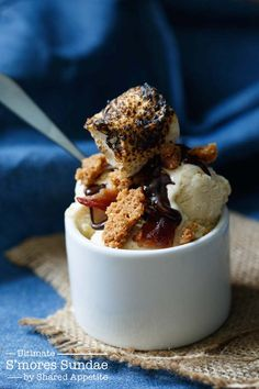 The Ultimate S'mores Sundae by @sharedappetite with homemade toasted marshmallow ice cream, dark chocolate ganache, graham cracker crumble, and candied bacon!