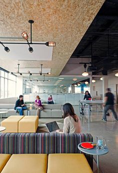 "AOL Office  ""This space is called ""The Town Hall"" and encourages employee collaboration by combining the kitchen, play space, and relaxation areas in one. It is centrally located to bring together employees from various departments that would not otherwise meet."""