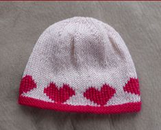 This easy knit stocking stitch beanie with garter stitch edge is knitted in two colours then heart motifs are embroidered (working form a graph) around the lower edge. Knitted Baby Beanies, Cute Beanies, Crochet Baby Hats, Knitted Hats, Baby Knitting Patterns, Craft Patterns, Embroidery Patterns, Knit Beanie Pattern, Headband Pattern