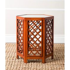 This Abbyson Living end table will be a stylish addition to every room in your home. Designed with sleek Moroccan cut-outs, this table features a rusty burgundy finish and a mirrored top.