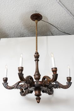 Hand Carved Beligum Wooden Chandelier, Circa 1900 | From a unique collection of antique and modern chandeliers and pendants  at http://www.1stdibs.com/furniture/lighting/chandeliers-pendant-lights/
