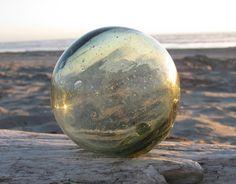 Japanese Glass Fishing Float - Grapefruit Size, Smokey Green. $24.99, via Etsy.