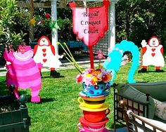 """mad hatter tea party; """"The hedgehog balls are made out of 4″ Styrofoam balls. I ripped up paper grocery bags and used Modpodge to apply them. Each ball took about 1/2 an hour…I made 16 of them. The mallets were 2′ stuffed flamingos.""""  http://www.designdazzle.com/2009/07/mad-hatter-tea-party/"""