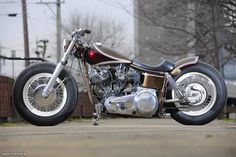 1983 HD FLH swingarm custom with white rims and lowrise bars | Gravel Crew | left side