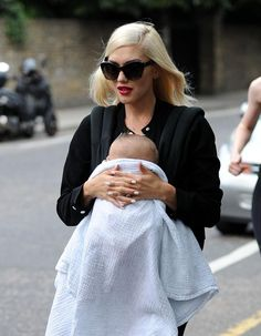 Beautiful Gwen Stefani wears Emmy with baby Apollo.