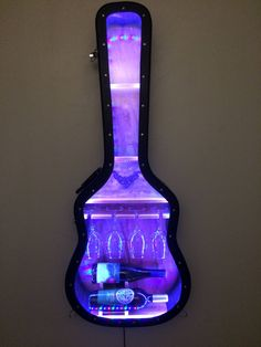 Guitar Case Shelf # Recycled hardshell guitar case with custom wine rack, glass display,color changing LED, plexi glas lid and 3 shelves by aRRtstudios on Etsy Guitar Shelf, Guitar Case, Guitar Diy, Guitar Room, Casa Mix, Music Furniture, Diy Projects For Bedroom, Wood Rack, Color Changing Lights