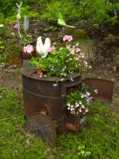What to do with an old wood stove? I recycle For several years now this old stove has been a focal point in my flower garden. I plant it each spring wit. Old Wood Stove Garden Junk, Garden Yard Ideas, Diy Garden, Lawn And Garden, Garden Pots, Yard Art, Container Plants, Container Gardening, Old Stove