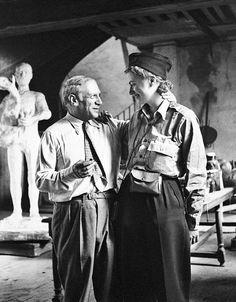 Août 1944. Lee Miller et Picasso, dans son atelier, rue des Grands Augustins, Paris.